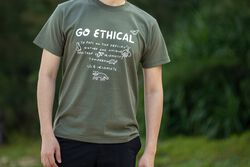 US 4 IRIOMOTE チャリティTシャツ『GO ETHICAL』 in Olive - on-body view.
