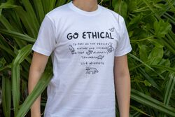 US 4 IRIOMOTE チャリティTシャツ『GO ETHICAL』 in White - on-body view.