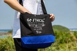 US 4 IRIOMOTEチャリティー 2WAY BAG  GO ECHICAL in Blue - on-body view.