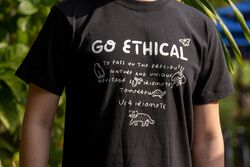 US 4 IRIOMOTE チャリティTシャツ『GO ETHICAL』 in Black - on-body view.