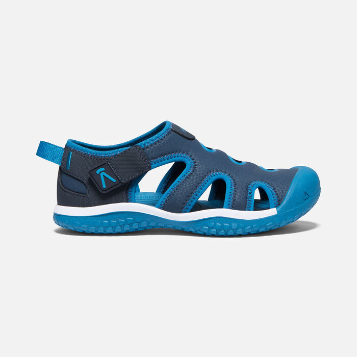 Big Kids' Stingray Sandal in Black Iris/Mykonos Blue - large view.